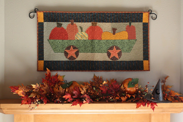 Fall Quilts above Fireplace